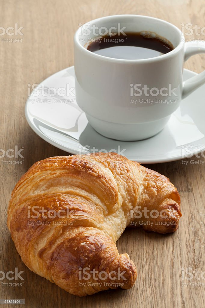 Fresh baked croissant and coffee stock photo