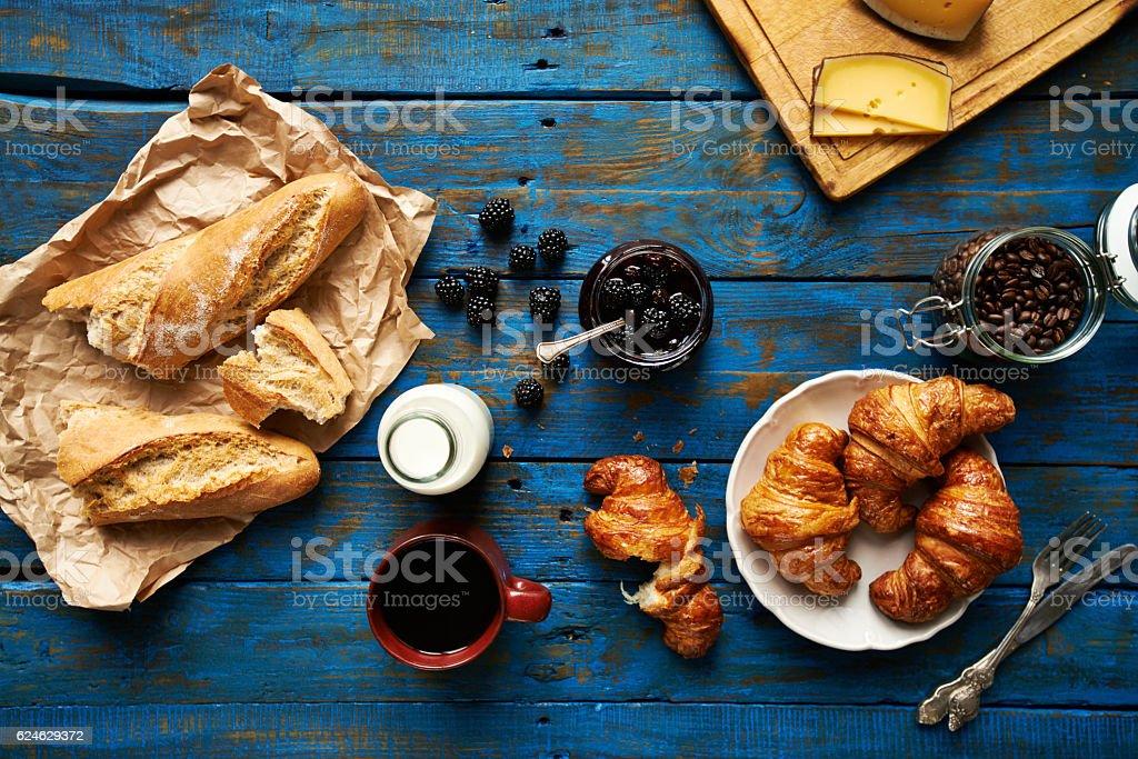 Fresh baked croissants and baguette, blackberry jam stock photo