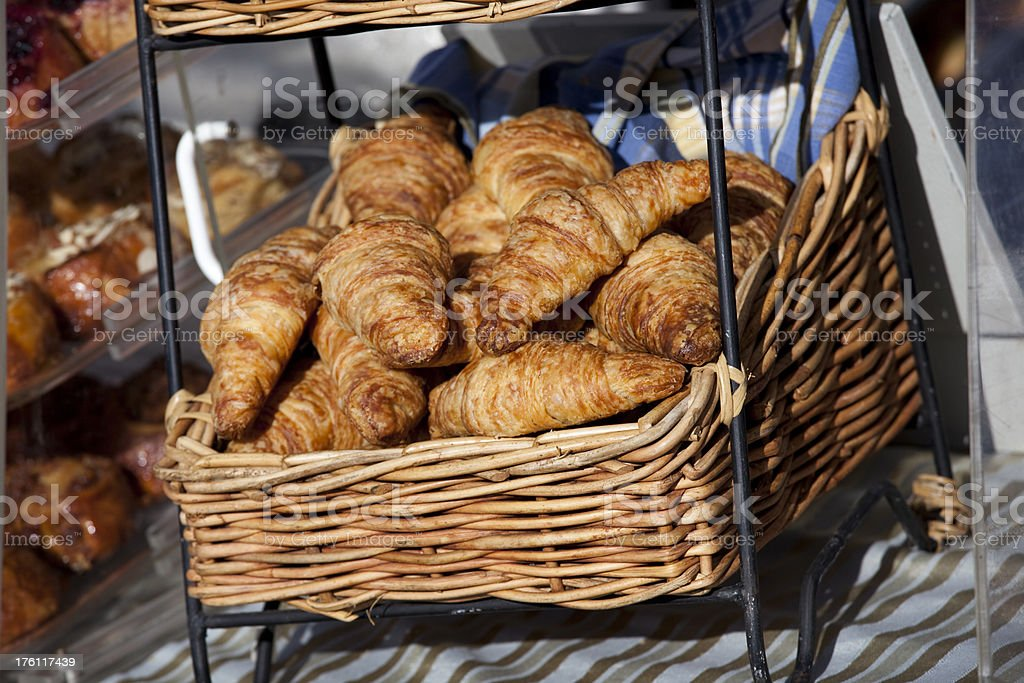 Fresh baked croissants at farmers market royalty-free stock photo