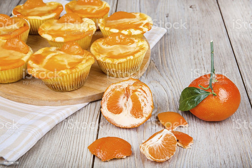 Fresh baked mini clementine cheesecakes in muffin forms royalty-free stock photo
