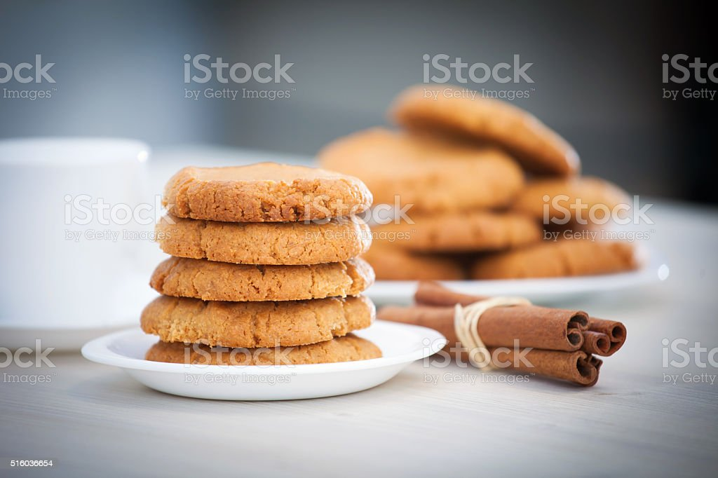 Fresh baked peanut butter cookies with cinamon sticks stock photo