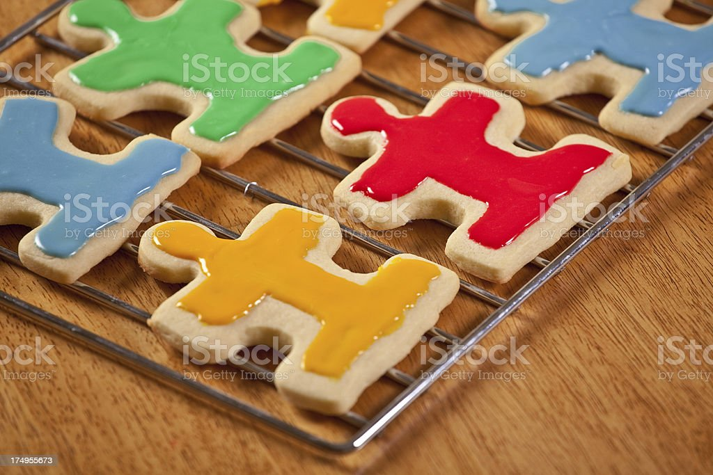 Fresh Baked Puzzle Piece Sugar Cookies Cooling on Rack stock photo