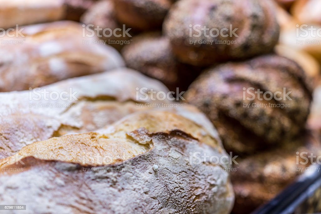 Fresh baked rustic bread display at bakery stock photo