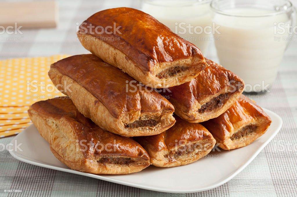 Fresh baked sausage rolls stock photo