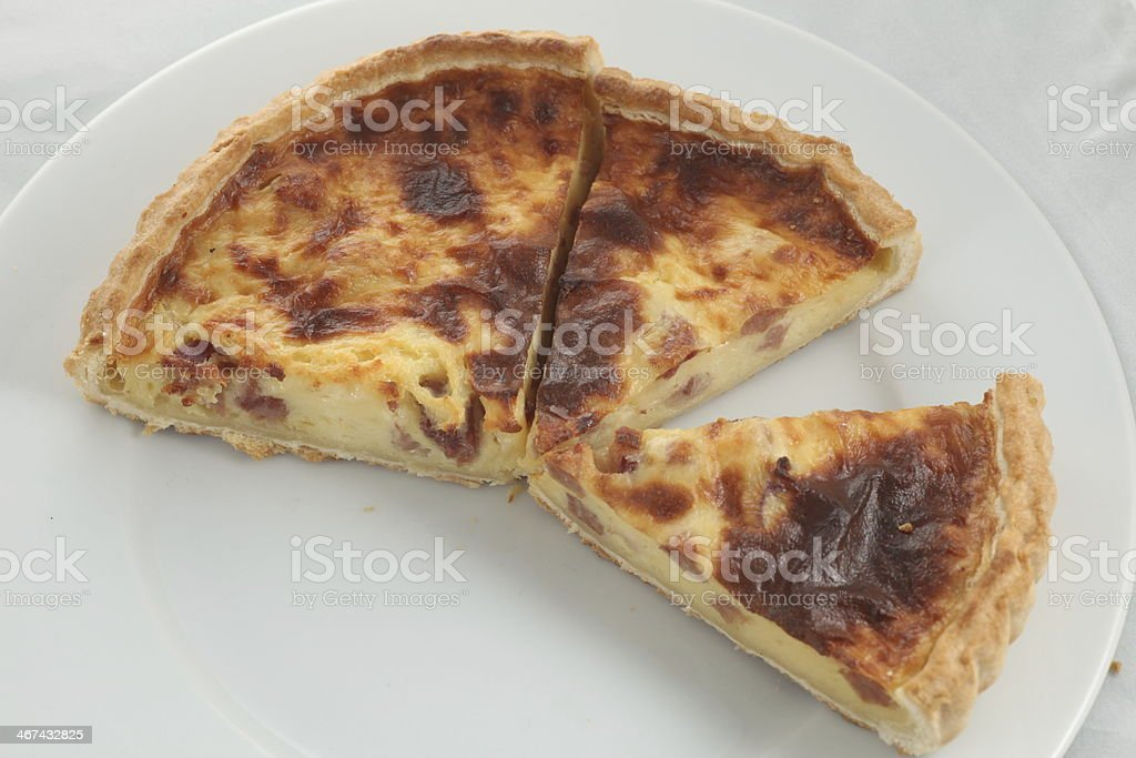 Fresh baked slice of quiche lorraine on a plate royalty-free stock photo