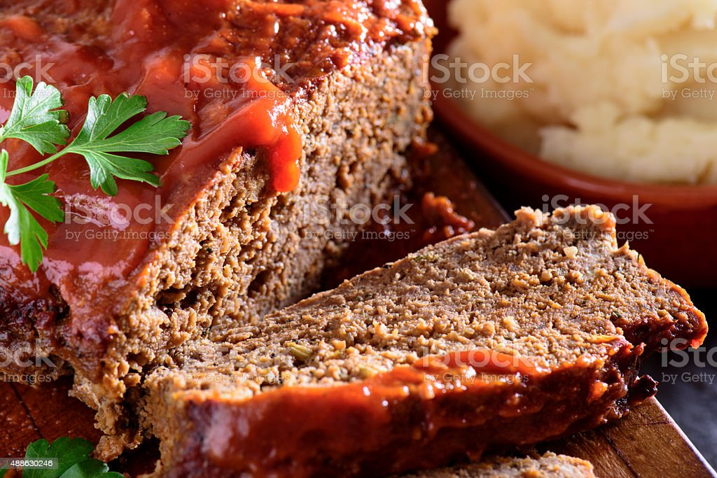 Fresh baked tomato glazed meatloaf served with mashed potato stock photo