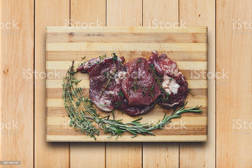 fresh beef meat on a cutting board stock photo