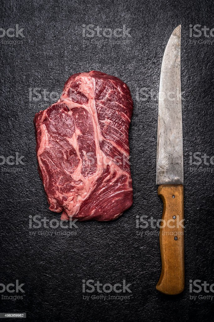 fresh beef steak carving knives  dark rustic background top view stock photo