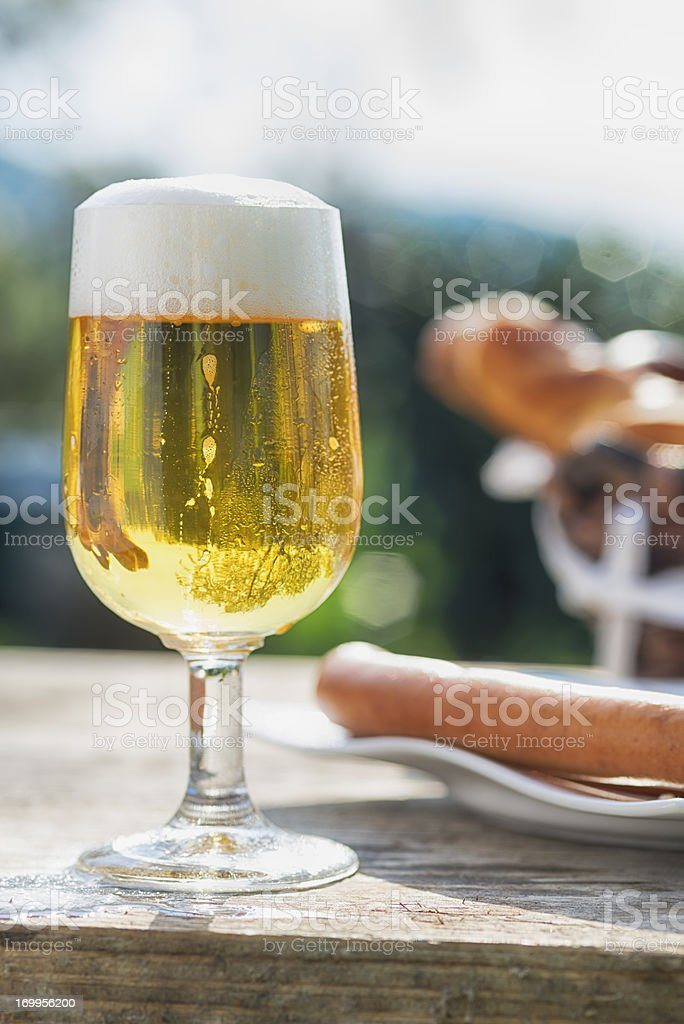 Fresh beer and Frankfurter sausages, German Style royalty-free stock photo