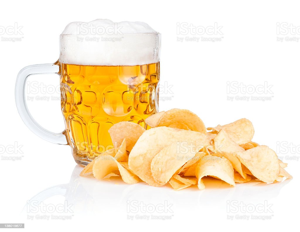 Fresh beer Mug with foam and Pile potato chips Isolated royalty-free stock photo