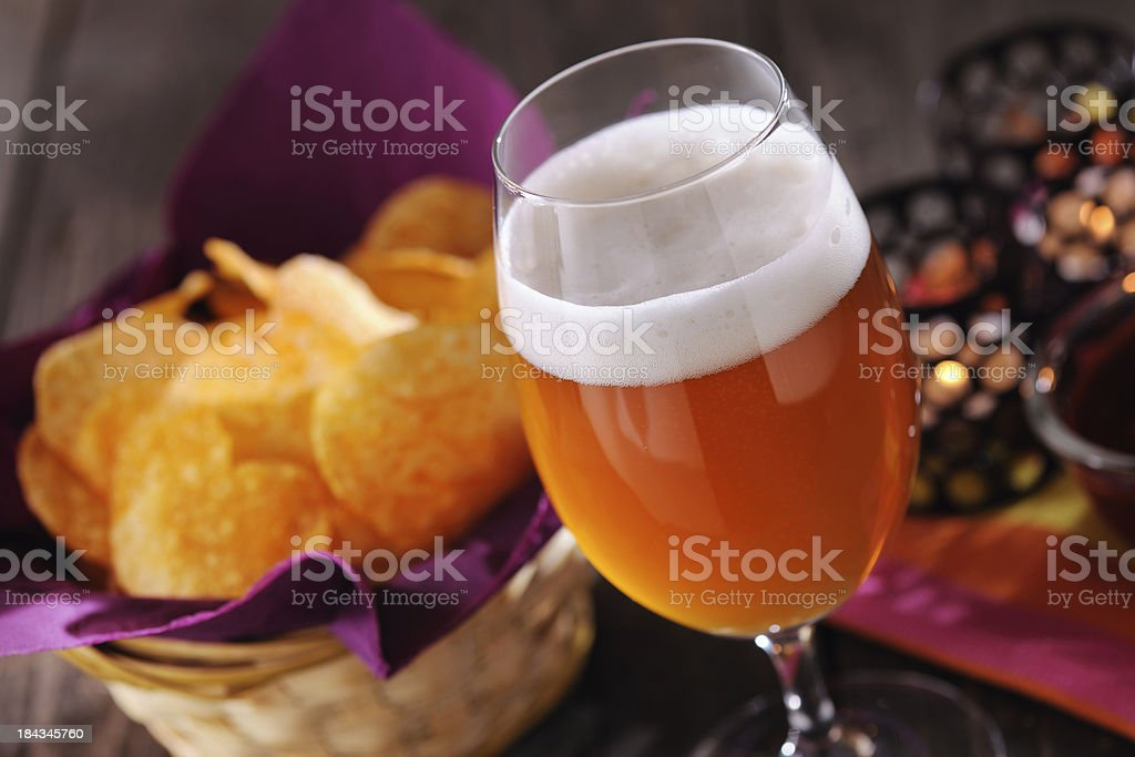Fresh beer with chips stock photo