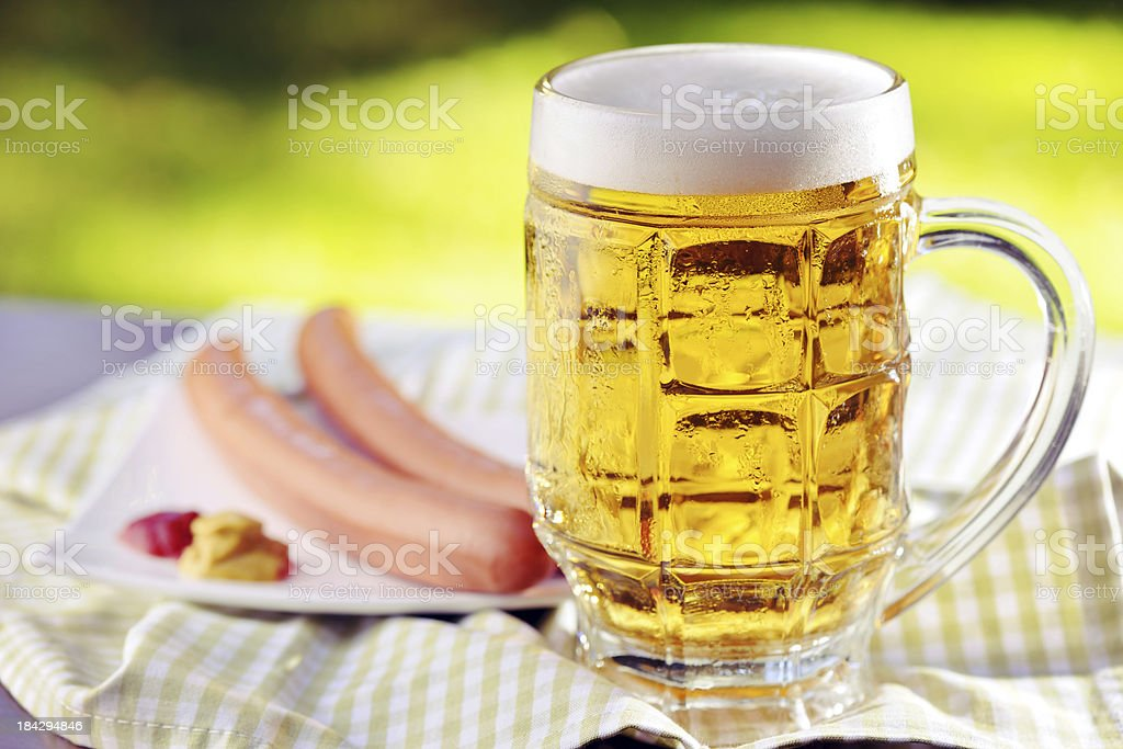 Fresh beer with sausage royalty-free stock photo