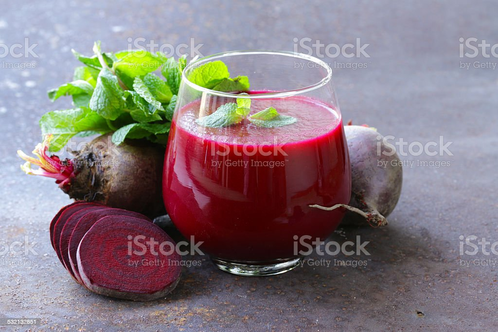 fresh beet juice with mint leaf in a glass stock photo