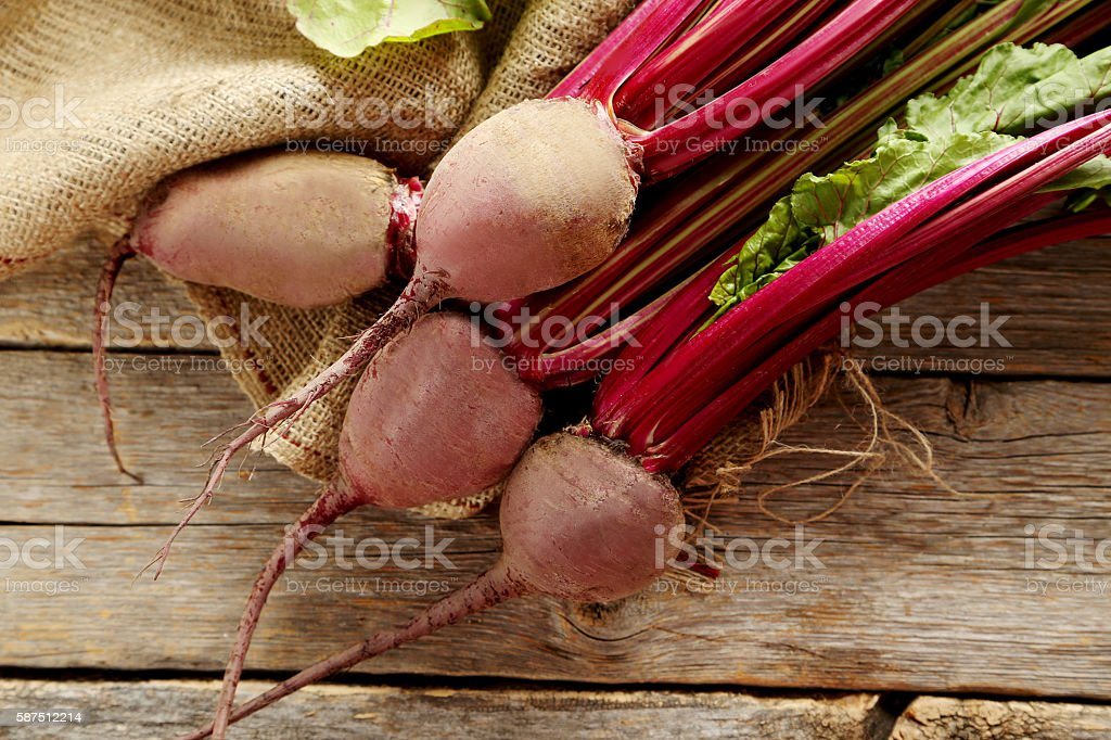 Fresh beets on a grey wooden table stock photo