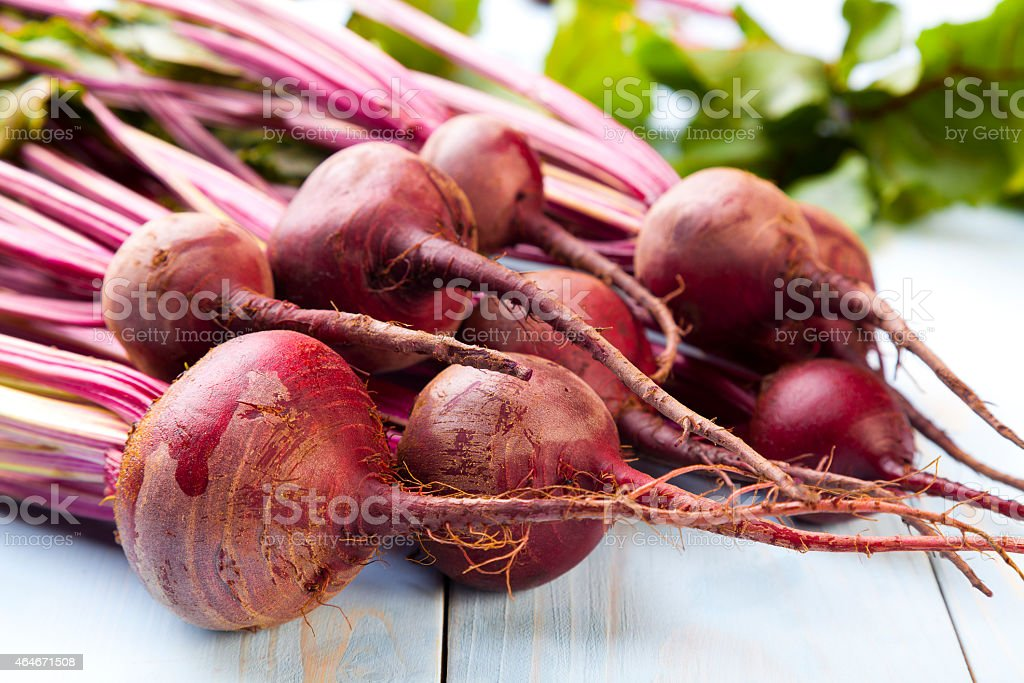 Fresh beets on a wooden board stock photo