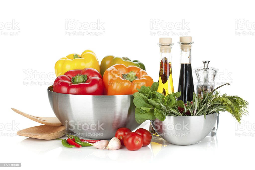 Fresh bell peppers and herbs in bowls royalty-free stock photo