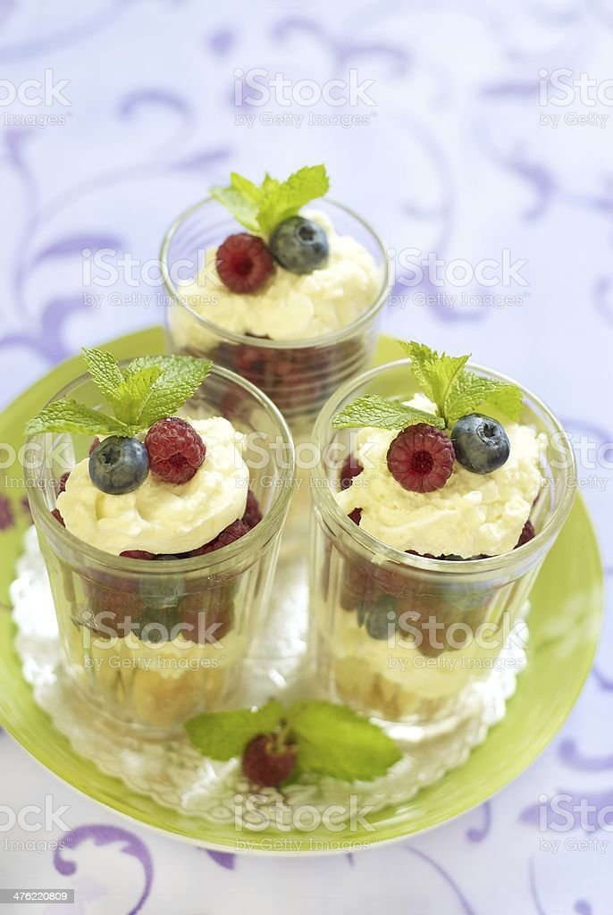 Fresh berries dessert with mascarpone and biscuit royalty-free stock photo