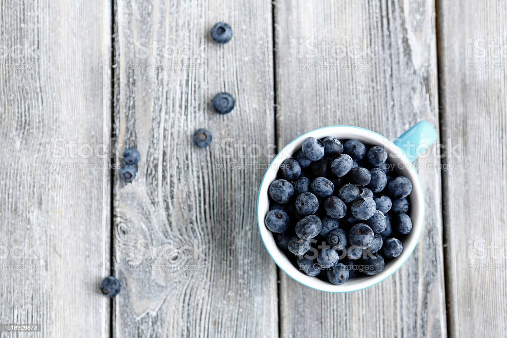 fresh berries in a cup - blueberries stock photo