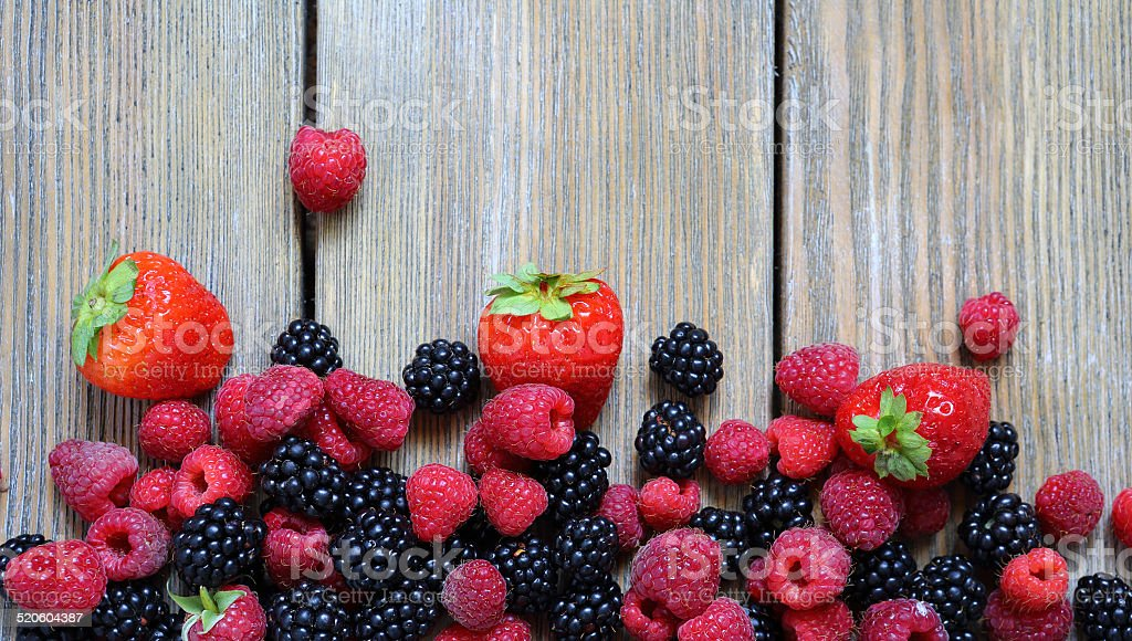 fresh berries on wooden background stock photo