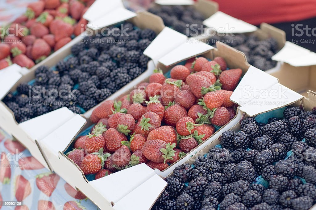 Fresh Berries, Raspberries and Blueberries at Farmers Market royalty-free stock photo