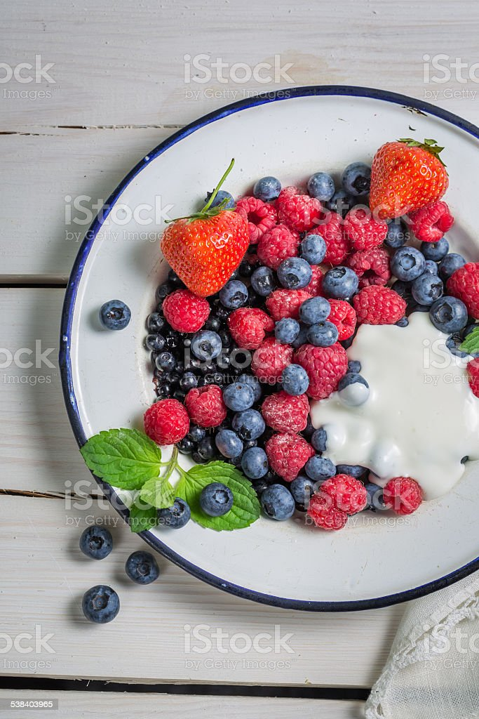 Fresh berry, strawberry and raspberry with cream stock photo