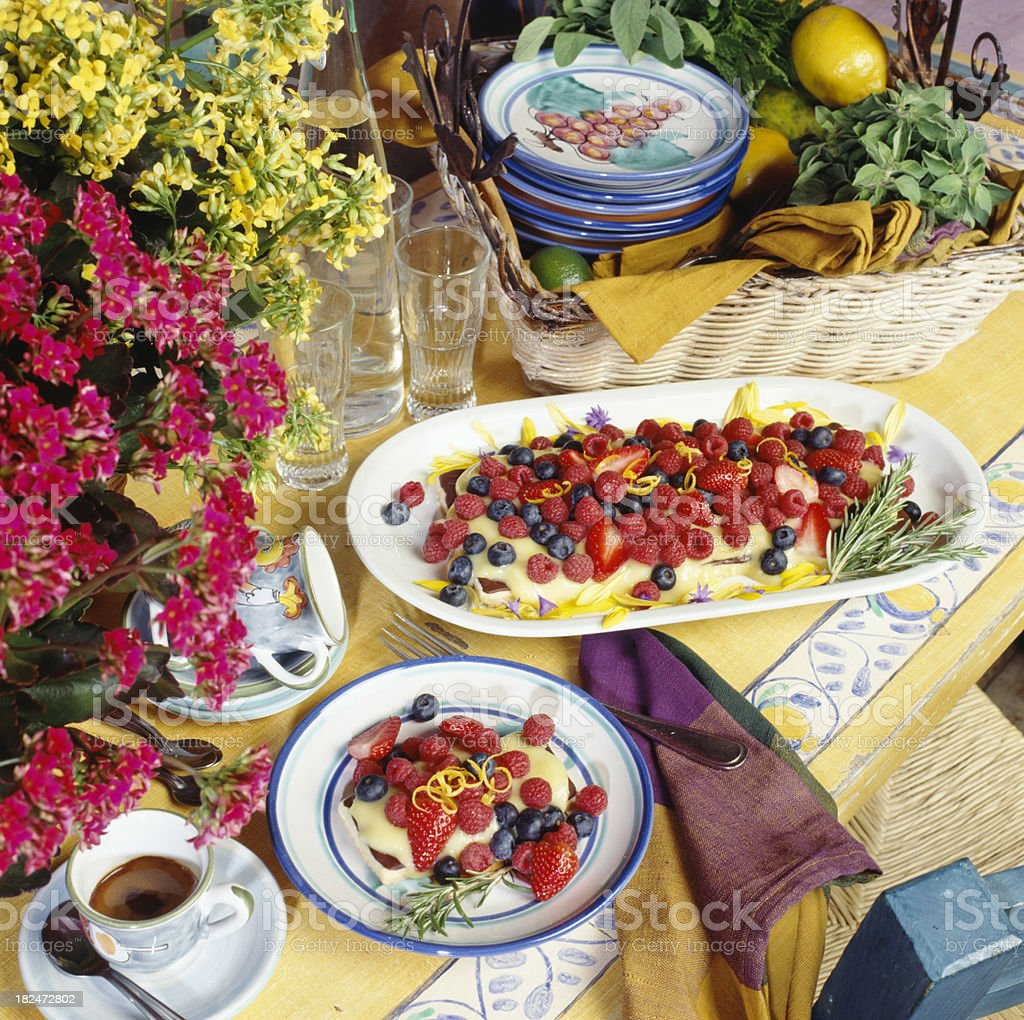 Fresh berry tart with coffee royalty-free stock photo