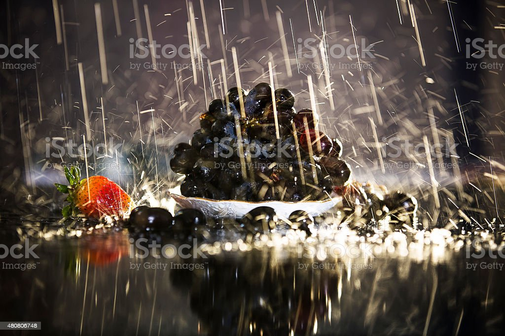 Fresh Black grapes Soaking in Rain stock photo