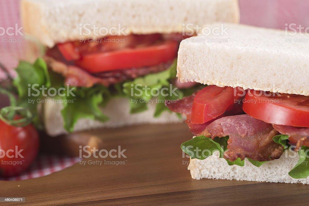 Fresh BLT on white sandwich in kitchen setting royalty-free stock photo