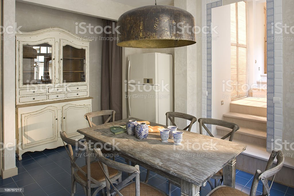 Fresh blue tiled floor dining area stock photo
