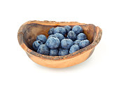 Fresh blueberries in a rustic wooden bowl