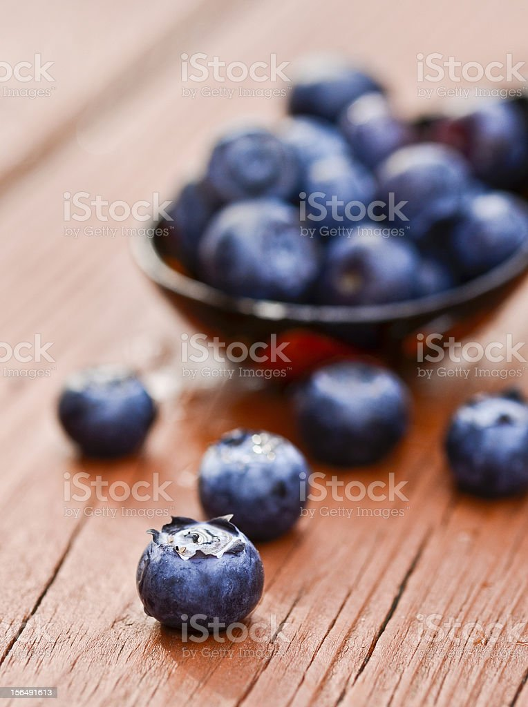 Fresh blueberries on a wooden board royalty-free stock photo