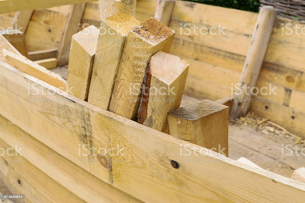 Fresh boards and wood shavings stock photo