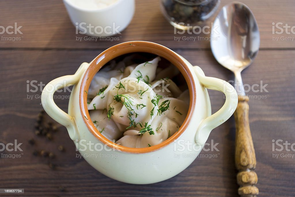 Fresh boiled meat dumplings served with dill royalty-free stock photo