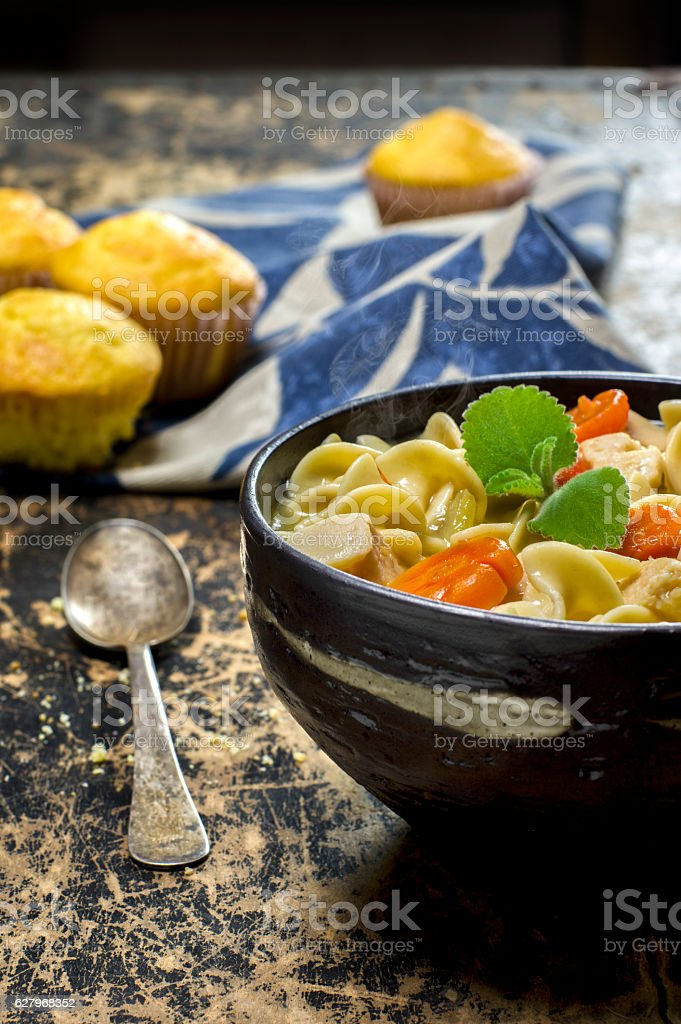 Fresh bowl of hot chicken noodle soup stock photo