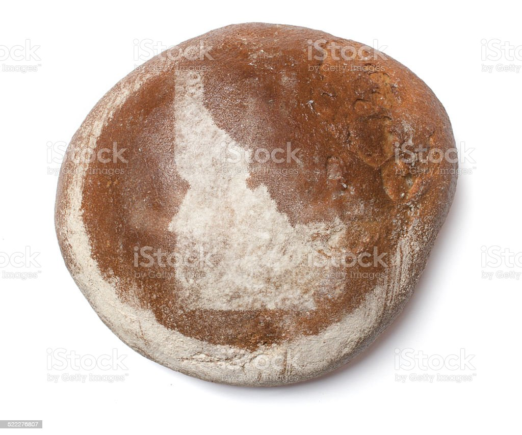 Fresh bread covered with rye flour shaping Idaho stock photo