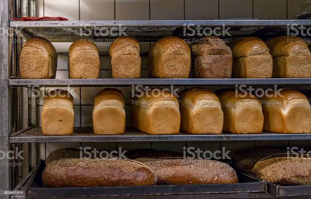 Fresh Bread in a Bakery in cooling rack stock photo