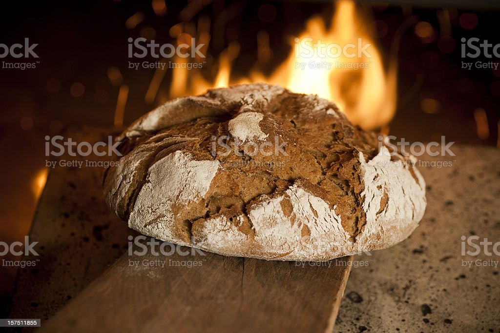 Fresh bread in oven royalty-free stock photo