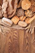 Fresh bread on wood