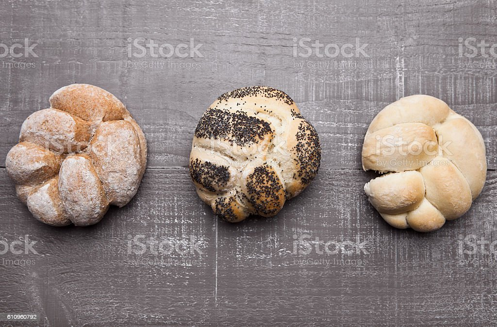 Fresh bread rolls for breakfast morning on wood stock photo