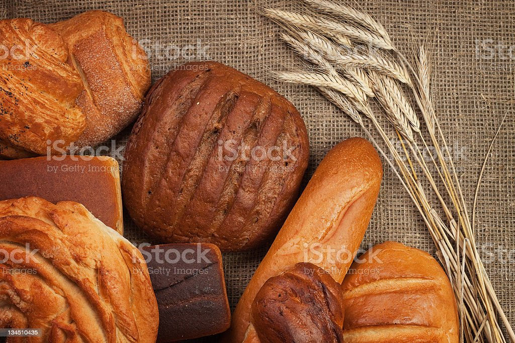 fresh bread with ears of rye royalty-free stock photo