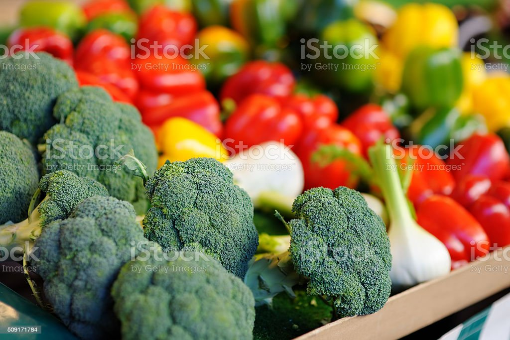 Fresh broccoli and paprika on farmer agricultural market stock photo