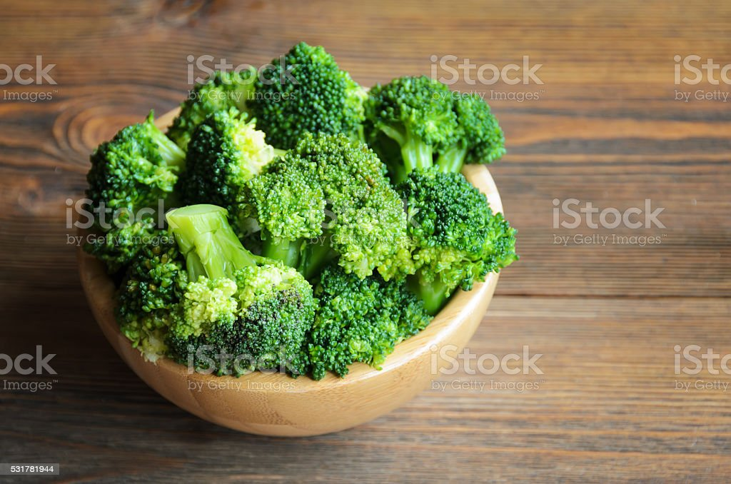Fresh broccoli in wooden bowl stock photo