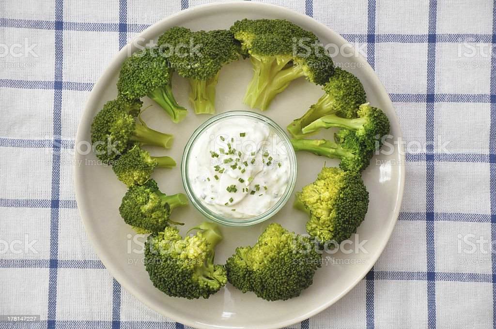 fresh broccoli with low fat dipping sauce royalty-free stock photo
