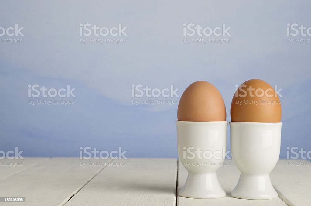 Fresh Brown Eggs in Cups stock photo