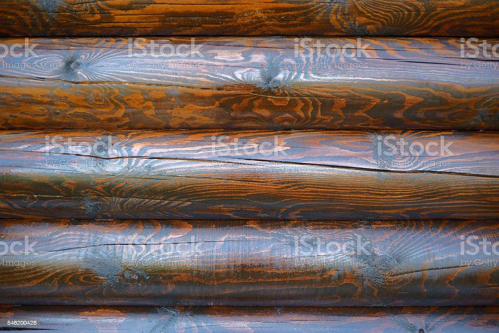 Fresh brown paint on log wall stock photo