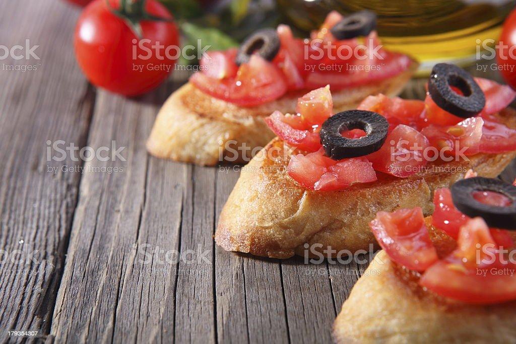 Fresh bruschetta tomato, olives royalty-free stock photo