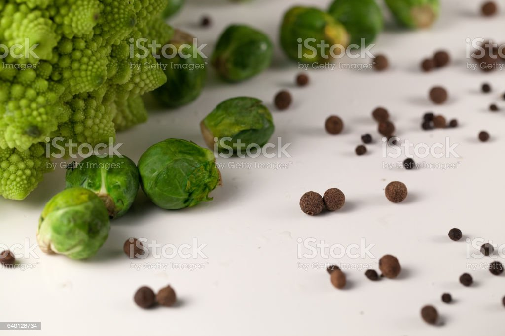 Fresh brusseles sprouts on a white surface stock photo