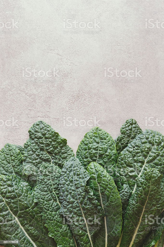 Fresh bunch of kale on rustic table stock photo
