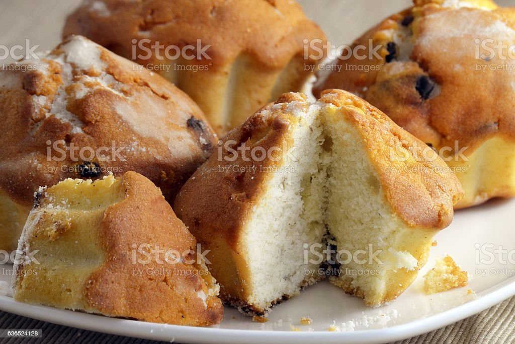 Fresh buns with raisins on a white plate close-up. stock photo