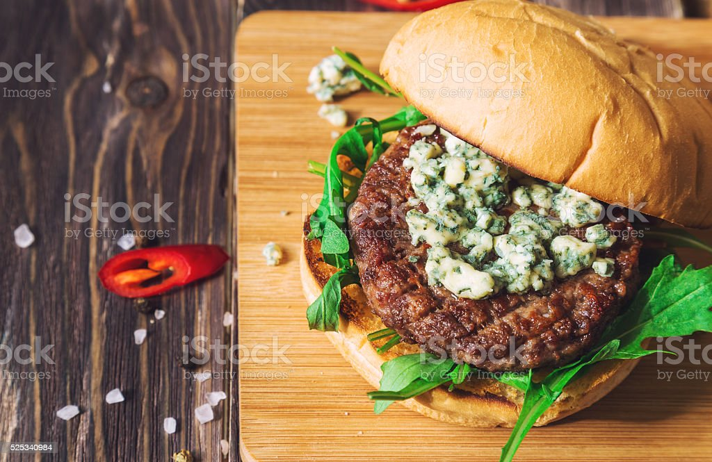 Fresh burger with blue cheese and arugula stock photo
